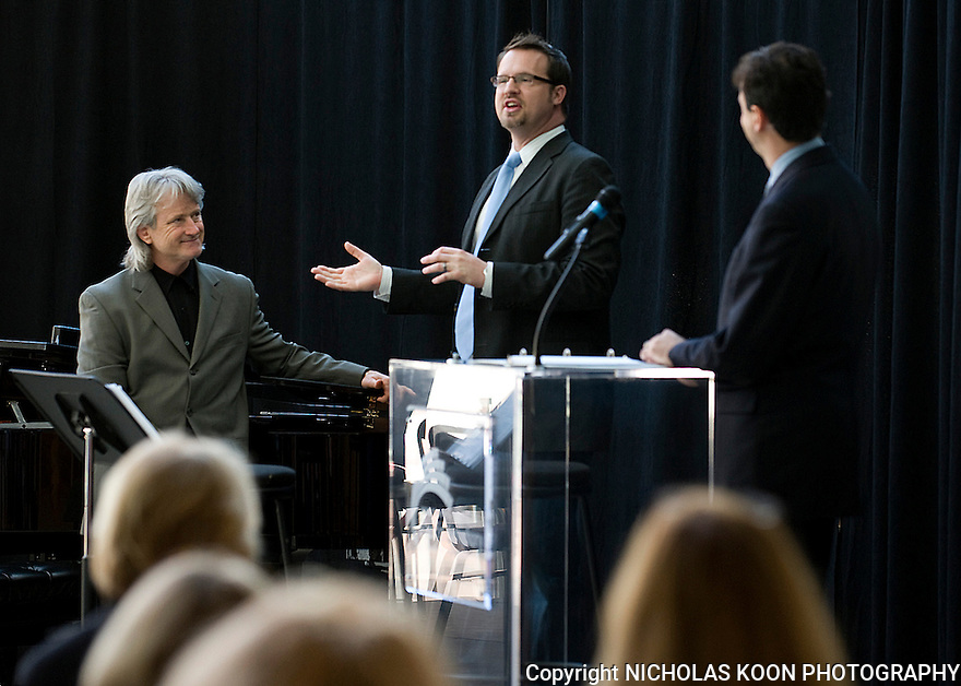 Stage Director for La Boheme, A. Scott Parry (center), assists Pacific Symphony Music Director Carl St. Claire and President John Forsyte in introducing the new season for the symphony which will include opera music performances.