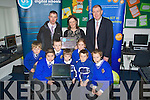 DIGITAL: Marie Lynch teacher at Scoil Mhuire nmBra?ithre,Clounalour, Tralee accepts the Digital School Award on Friday at the school looking on were pupils and teachers : Front l-r: Gary Fitzgerald,Donal Dillane, Ben Flavey, Jamie O'Callaghan, Tom O'Farrell, Craig O'Brien and Chloe Cahill. Michael O'Callaghan (chairman of the parents council), Marie Lynch and Denis Coleman (principal)....