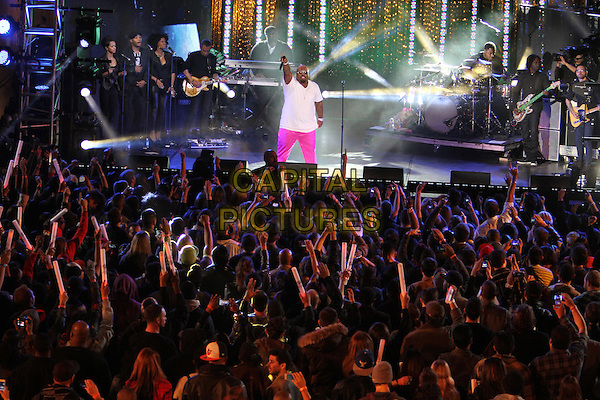 "Cee Lo Green (Thomas DeCarlo Callaway).Caesars Entertainment Kick-Off Of ""Escape To Total Rewards"" , Los Angeles Show Held At Hollywood & Highland Center, Hollywood, California, USA, 1st March 2012..music concert gig live on stage  half 3/4 length pink trousers white t-shirt crowd audience sunglasses  performing hand arm raised up microphone singing .CAP/ADM/KB.©Kevan Brooks/AdMedia/Capital Pictures."