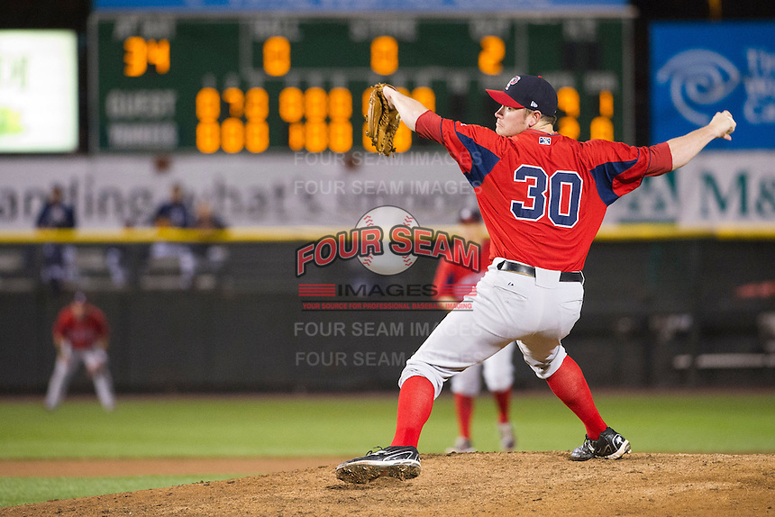 Pawtucket Red Sox closer Alex Wilson #30 delivers the last pitch of game four of a best of five playoff series against the Empire State Yankees at Frontier Field on September 8, 2012 in Rochester, New York.  Pawtucket defeated Empire State 7-1 to advance to the International League Finals.  (Mike Janes/Four Seam Images)