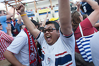Kansas City, MO - Monday, June 16, 2014:  USA soccer fans cheer after the USA scored a goal in the second half of the USA vs. Ghana first round World Cup match at a public viewing in the Power and Light District of Kansas City, Missouri.