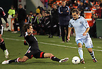 10 March 2012: DC's Josh Wolff (left) tries to tackle the ball away from Kansas City's Graham Zusi (8). Sporting Kansas City defeated DC United 1-0 at RFK Stadium in Washington, DC in a 2012 regular season Major League Soccer game.