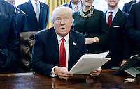 United States President Donald Trump speaks before signing an executive order establishing regulatory reform officers and task forces in US agencies in the Oval Office of the White House on February 24, 2017 in Washington, DC. Photo Credit: Olivier Douliery/CNP/AdMedia