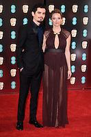 Damien Chazelle &amp; Olivia Hamilton at the 2017 EE British Academy Film Awards (BAFTA) held at The Royal Albert Hall, London, UK. <br /> 12 February  2017<br /> Picture: Steve Vas/Featureflash/SilverHub 0208 004 5359 sales@silverhubmedia.com