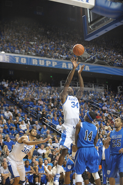 Junior DeAndre Liggins takes a shot during the UK mens basketball Dillard exhibition game. Photo by Mike Weaver | Staffff