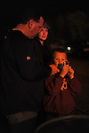 """Stephen Kea and Darlene Kea of Jarratt, Virginia stand with their seven year old son, Colby Kea, to show their support for the victims of John Allen Muhammad, the so-called """"Washington sniper"""" responsible for gunning down 10 and wounding three in the D.C.-area in 2002, near the entrance to the Greensville Correctional Center hours before Muhammad's 9 p.m. execution in Jarratt, Virginia on November 10, 2009.  Virginia Governor Tim Kaine refused to grant a stay of clemency and the U.S. Supreme Court turned down the request for a stay of execution despite religious objections due to Muhammad's mental health."""