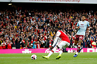 Nicolas Pépé of Arsenal retrieves the ball after scoring his penalty during the Premier League match between Arsenal and Aston Villa at the Emirates Stadium, London, England on 22 September 2019. Photo by Carlton Myrie / PRiME Media Images.