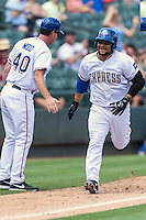 Round Rock catcher Tomas Telis (6) is congratulated by Manager Jason Wood (40) as he scampers toward the home plate after a two run homer a the bottom of fifth during a baseball game, Sunday May 03, 2015 in Round Rock, Tex. Express sweep four game series by defeating Sounds 5-4. (Mo Khursheed/TFV Media via AP images)