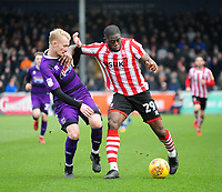 Lincoln City's John Akinde battles with Grimsby Town's Ludvig Ohman<br /> <br /> Photographer Andrew Vaughan/CameraSport<br /> <br /> The EFL Sky Bet League Two - Lincoln City v Grimsby Town - Saturday 19 January 2019 - Sincil Bank - Lincoln<br /> <br /> World Copyright © 2019 CameraSport. All rights reserved. 43 Linden Ave. Countesthorpe. Leicester. England. LE8 5PG - Tel: +44 (0) 116 277 4147 - admin@camerasport.com - www.camerasport.com