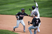 New Britain Rock Cats second baseman Juan Ciriaco (2) tags Destion Hood (20), who was called safe at second, in a run down during a game against the Akron RubberDucks on May 21, 2015 at Canal Park in Akron, Ohio.  Akron defeated New Britain 4-2.  (Mike Janes/Four Seam Images)