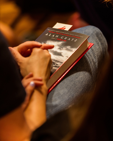 """July 26, 2017. Raleigh, North Carolina.<br /> <br /> Many attendees bought copies of Alan Gratz's new book """"Refugee"""" at the signing. <br /> <br /> Author Alan Gratz spoke about and signed his new book """"Refugee"""" at Quail Ridge Books. The young adult fiction novel contrasts the stories of three refugees from different time periods, a Jewish boy in 1930's Germany , a Cuban girl in 1994 and a Syrian boy in 2015."""