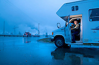 Fort McMurray, Alberta, Canada - August 13, 2008 - John Griffiths parks his RV near rows of oil refineries in Fort McMurray, Alberta, Canada.