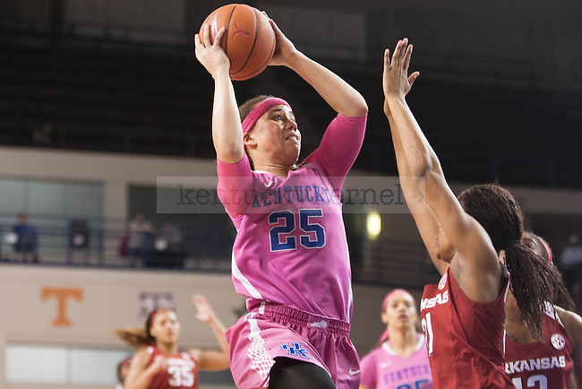 Junior guard Makayla Epps (25) shoots the ball over a defender during the game against the Arkansas Razorbacks on Sunday, February 21, 2016 in Lexington, Ky. Kentucky won the game 77-63. Photo by Hunter Mitchell   Staff