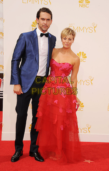 LOS ANGELES, CA- AUGUST 25: Actress Kaley Cuoco (R) and husband Ryan Sweeting arrive at the 66th Annual Primetime Emmy Awards at Nokia Theatre L.A. Live on August 25, 2014 in Los Angeles, California.<br /> CAP/ROT/TM<br /> &copy;Tony Michaels/Roth Stock/Capital Pictures