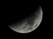 Half Moon taken from the ground on Thursday, March 29, 2012.  Many craters and seas can be clearly seen..Credit: Ron Sachs / CNP