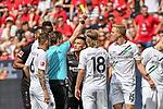12.05.2018, BayArena, Leverkusen, GER, 1.FBL, Bayer 04 Leverkusen vs Hannover 96, im Bild Guido Winkmann (SR) (Schiedsrichter, referee), gilbt Timo Huebers / H&uuml;bers (#15, Hannover 96) Gelb / gelbe Karte <br /> <br /> <br /> Foto &copy; nordphoto/Mauelshagen