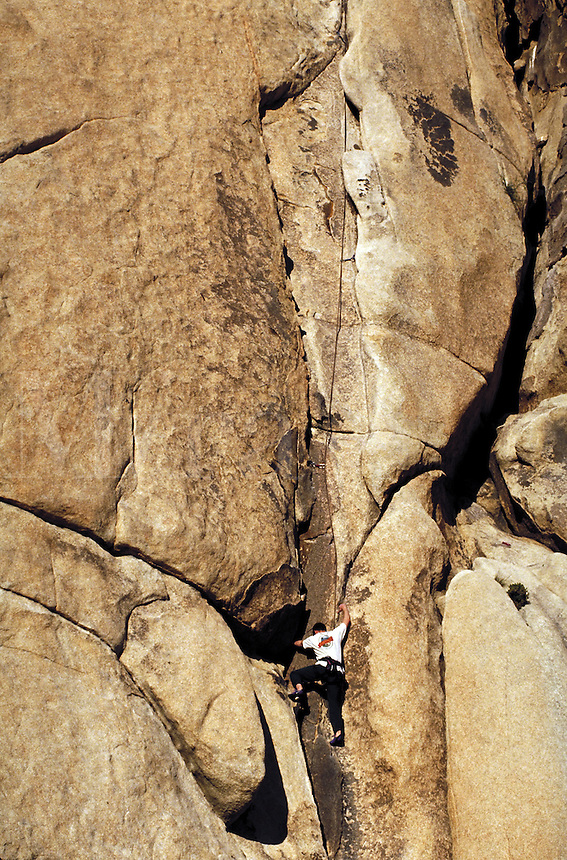 Man rock climbing, Joshua Tree National Monument, California