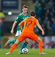 16th November 2019; Windsor Park, Belfast, Antrim County, Northern Ireland; European Championships 2020 Qualifier, Northern Ireland versus Netherlands; Gavin Whyte of Northern Ireland tries to get past Daley Blind of Netherlands - Editorial Use