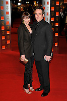 KEELEY HAWES & MATTHEW MACFADYEN.The Orange British Academy Film Awards 2009, Royal Opera House, Covent Garden, London, England, February 8th 2009..BAFTAS arrivals full length black suit tie trouser blazer jacket husband wife sandals trousers gold clutch bag .CAP/PL.©Phil Loftus/Capital Pictures Oscars