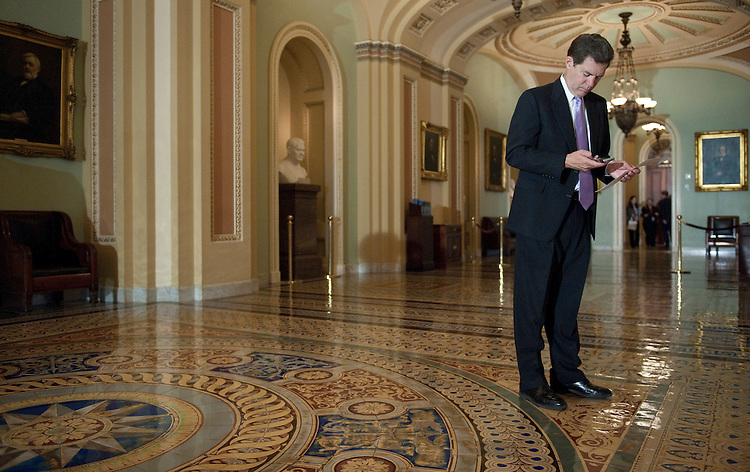 UNITED STATES - SEPTEMBER 14: Sen. Sam Brownback, R-Kan., checks his blackberry in the Ohio Clock Corridor as he leaves the Senate Floor on Tuesday, Sept. 14, 2010. (Photo By Bill Clark/Roll Call via Getty Images)