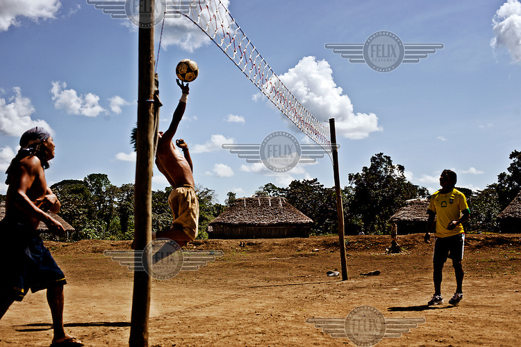 Young people play volleyball in the community of Kusutkau.