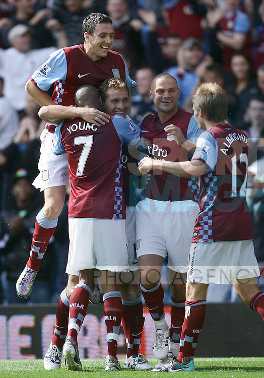 All smiles from Villa's Stewart Downing, Ashley Young , Luke Young and Marc Albrighton following Stilyan Petrov's(centre)  goal.