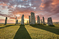 Calanais Standing Stones central stone circle, at sunset,  erected between 2900-2600BC measuring 11 metres wide. At the centre of the ring stands a huge monolith stone 4.8 metres high weighing about 7 tonnes, which is perfectly orientated so that its widest sides face due north south. Calanais Neolithic Standing Stone (Tursachan Chalanais) , Isle of Lewis, Outer Hebrides, Scotland.