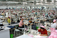 Hundreds of workers are packed int a textile factory in the Jiangsu special Development Zone that makes clothes for western companies including Umbro sports and New Balance. Much of the world's textile manufacture has moved to China due to relatively low labor rates and high productivity..23 Sep 06