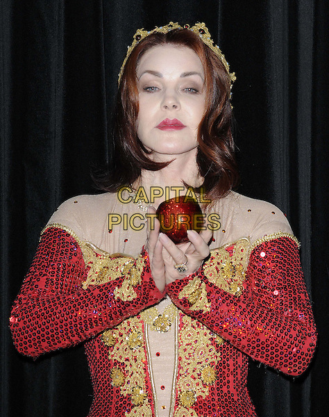 Priscilla Presley.Press launch to star in New Wimbledon Theatre's annual pantomime offering 'Snow White and the Seven Dwarfs' at The Savoy, Strand, London, England..September 26th, 2012.panto costume half length gold red dress crown sequins sequined apple hands arms.CAP/CAN.©Can Nguyen/Capital Pictures.