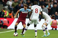 Mark Noble of West Ham United and Cheikhou Kouyate of Crystal Palace during West Ham United vs Crystal Palace, Premier League Football at The London Stadium on 5th October 2019