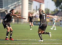 Christine Sinclair, left, congratulates Rachel Buehler, right, after scoring a goal, FC Gold 1, St. Louis Athletica 1, at Buck Shaw Stadium, in Santa Clara, Calif., Sunday, August 9, 2009.
