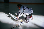 Los Angeles Chef Sang Yoon ties his laces on his ice skates on the ice before playing hockey with a friend at Toyota Sports Center in El Segundo, California December 17, 2015.<br /> <br /> CREDIT: Kendrick Brinson for The Wall Street Journal