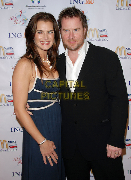 BROOKE SHIELDS & CHRIS HENCHY .attends Noche de Ninos Gala benefiting Children's Hospital of Los Angeles held at The Beverly Hilton Hotel, .Beverly Hills, California, USA, October 7th 2006. .half length couple blue and white dress necklace sheilds.Ref: DVS.www.capitalpictures.com.sales@capitalpictures.com.©Debbie VanStory/Capital Pictures
