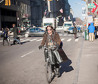 Messenger delivering packages bikes  down Fifth Avenue in New York on Friday, December 13, 2013 during the Christmas shopping season. There are only twelve more days until Christmas!(© Richard B. Levine)