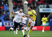 Blackburn Rovers' Charlie Mulgrew heads clear under pressure from Bolton Wanderers' Will Buckley<br /> <br /> Photographer Andrew Kearns/CameraSport<br /> <br /> The EFL Sky Bet Championship - Bolton Wanderers v Blackburn Rovers - Saturday 6th October 2018 - University of Bolton Stadium - Bolton<br /> <br /> World Copyright &copy; 2018 CameraSport. All rights reserved. 43 Linden Ave. Countesthorpe. Leicester. England. LE8 5PG - Tel: +44 (0) 116 277 4147 - admin@camerasport.com - www.camerasport.com