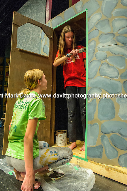 Stage workers Leah Bergman and Kayla Armantrout, standing, are busy getting the sets ready for Southeast Polk High School's Beauty and the Beast to be presented Nov. 11 at 7 p.m. and Nov. 12 at 7 p.m. In addition, on Nov. 12 at 10–11:30 a.m. The players will host a VIP Enchanted Event in which  guests can meet Bell, the Beast, and other characters.