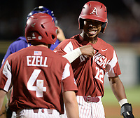 NWA Democrat-Gazette/ANDY SHUPE<br /> Arkansas pinch-runner Curtis Washington Jr. (right) and first baseman Trevor Ezell celebrate Friday, May 10, 2019, after scoring during the eighth inning against LSU at Baum-Walker Stadium in Fayetteville. Visit nwadg.com/photos to see more photographs from the game.