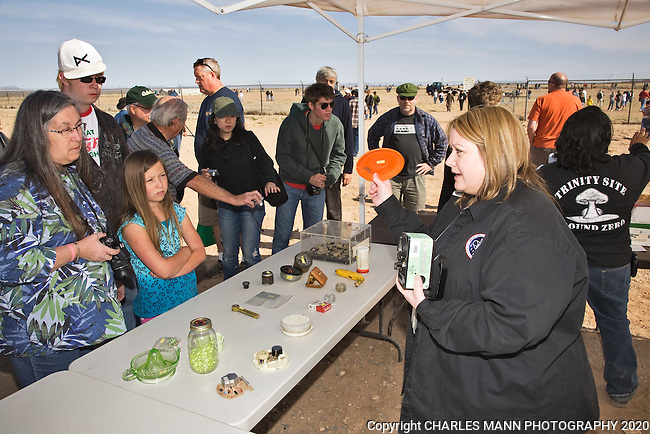 Health Physicist Shannan Boggs greets visitors to Ground Zero at the Trinity Atomic Test Site and explains that many ordinary objects demonstrate radioactivity, including cigarettes, bananas, and kitty litter.