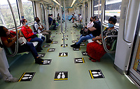 MEDELLÍN, COLOMBIA-MAY 4: People wear face masks and sit in designated seats in a subway car as a preventive measure against the spread of the new coronavirus COVID-19, in Medellín, Colombia, on May 4, 2020. The distance physical and the maximum occupation of 35% of the public transport system, a requirement of the National Government, as a preventive measure to stop the spread of COVID-19 (Photo by Fredy Builes/VIEWpress)