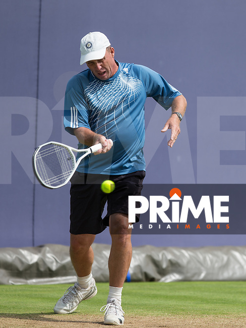 Ivan Lendl has a knock about as he waits for Andy Murray during the Queen's Club Aegon Championships 2016 Men's Singles Final between Andy Murray & Milos Raonic at The Queen's Club, London, England on 19 June 2016. Photo by Andy Rowland.