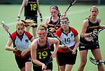 FRANKFURT AM MAIN, GERMANY - April 14: (L-R) Isabelle Schimek #71 of Austria, Emily Patterson #19 of Germany, Colleen O'Connor #15 of Germany, Katharina Bierbacher-Voss #16 of Austria and Inga Hupka #8 of Germany during the Deutschland Lacrosse International Tournament match between Germany vs Austria on April 14, 2013 in Frankfurt am Main, Germany. Germany won, 10-4. (Photo by Dirk Markgraf)
