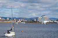 CARDIFF, UK. 2nd April 2017. A boat sails in Cardiff Bay in warm sunny weather.
