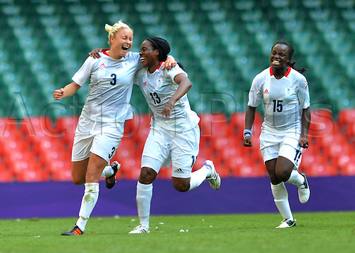 25.07.2012. Cardiff, Wales.  Stephanie Houghton, Ifeoma Dieke and Eniola Aluko of Great Britain Celebrate Scoring during The Preliminary Round Group E Match of Women s Football between Great Britain and New Zealand in Cardiff Wales.   Great Britain Won The Match 1 0