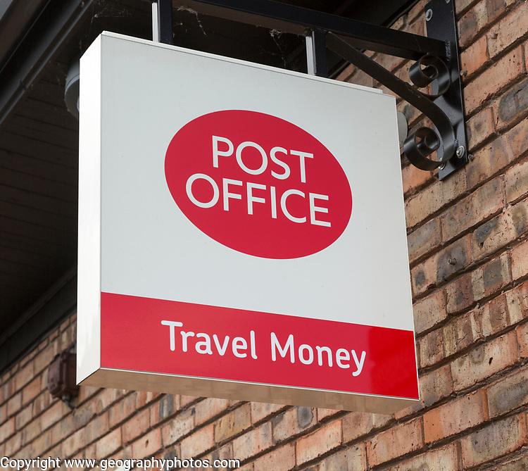 Close up Post Office travel money sign, Woodbridge, Suffolk, England, UK