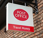 Close up Post Office travel money sign, Woodbridge, Suffolk, England, UK