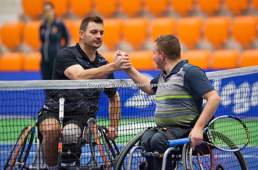 Rotterdam,Netherlands, December 15, 2015,  Topsport Centrum, Lotto NK Tennis, Wheelchair tennis, Ricky Mollier  (NED) is  congratulated  as winner  by Mitchel Graauw (R)<br /> Photo: Tennisimages/Henk Koster