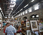 People browsing inside a traditional market place building  at the Pannier Market, Tavistock, Devon, England