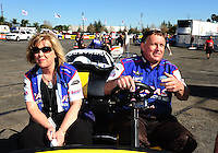 Feb. 9, 2012; Pomona, CA, USA; NHRA pro stock driver Larry Morgan (right) and wife Diane Morgan during qualifying at the Winternationals at Auto Club Raceway at Pomona. Mandatory Credit: Mark J. Rebilas-