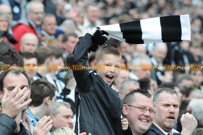 A young Newcastle United fan before kick off - Newcastle United vs Sunderland - Barclays Premier League Football at St James Park, Newcastle upon Tyne - 14/04/13 - MANDATORY CREDIT: Steven White/TGSPHOTO - Self billing applies where appropriate - 0845 094 6026 - contact@tgsphoto.co.uk - NO UNPAID USE
