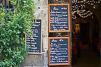 French menus outside cafe restaurant in Bordeaux, France.